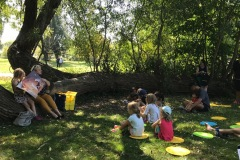 Stories under a tree by Long Branch Library